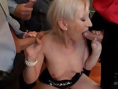 Compacted bukkake scene with cocksucking blonde
