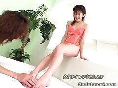Young Japanese shemale fingered in the arse