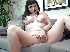 Carrie Ann is a raven haired tattooed milf with beamy